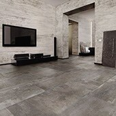 Large monochrome media room with large screen tv and large format tile on the walls and floors
