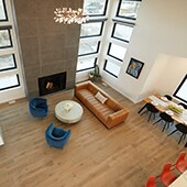 Birds eye view of open format living and dining room with wood look tile flooirng
